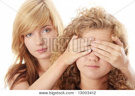 Don't look - censorship concept - two teen girls isolated on white