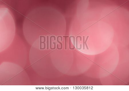 Abstract defocused chrystals, large bright circles in pink and red.