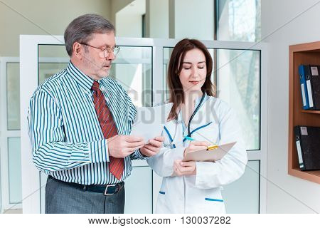 The patient and his doctor in medical office. Healthcare concept