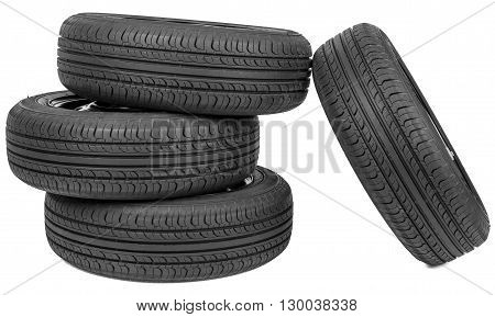 Stack of four wheel new black tyres, isolated on white background