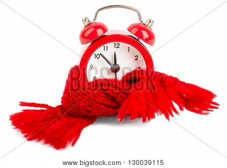 Preservation of time. Red alarm clock wearing red scarf. Isolated on white background