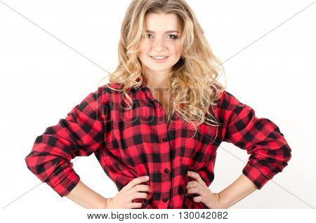 Young Beautiful Curly Woman Standing With Arms Akimbo