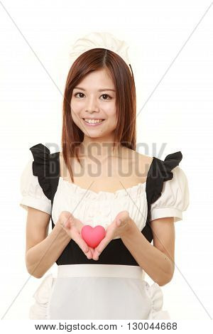 portrait of young Japanese woman wearing french maid costume with pink heart on white background