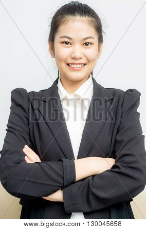 Happy Young Asian Girl With Folded Arms In Black Suit