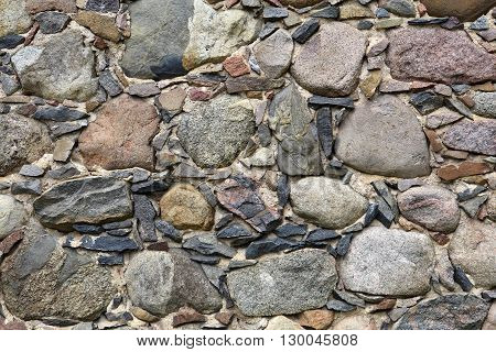 Hand made ancient rustic stone wall background.
