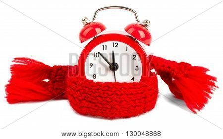 Alarm clock wearing red scarf. Isolated on white background