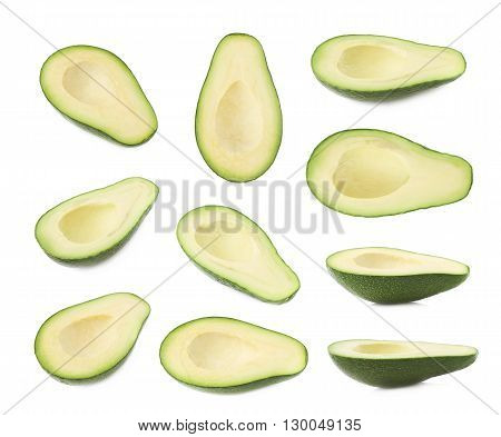 Half of ripe avacado fruit without the pit, composition isolated over the white background, set of multiple different foreshortenings