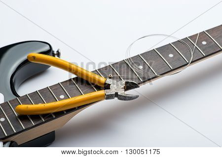 Guitar Frets With String And Yellow Nippers