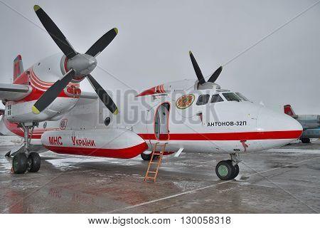 Nezhin Ukraine - January 14 2011: Antonov An-32 firefighter plane being prepared for a training flight
