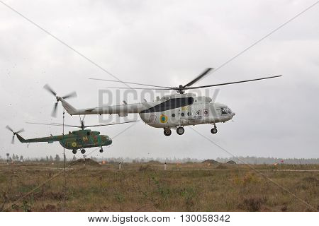 Zhitomir Ukraine - September 29 2010: Ukrainian Army military transport helicopters are landing in bad weather conditions during the military trainings