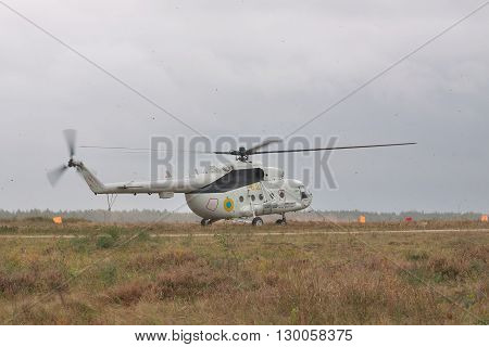 Zhitomir Ukraine - September 29 2010: Ukrainian Army military transport helicopter landed on the field in heavy storm during the military trainings