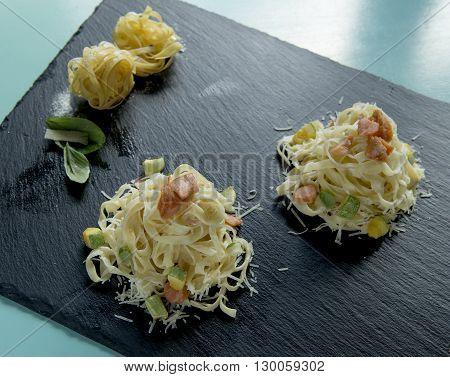 tagliatelle with salmon and zucchini in a white cream sauce