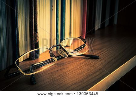 Old Reading Glasses and Books. Literature Reading.