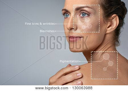 Portrait of confident elegant middle age woman in studio, beauty skin care wellness concept