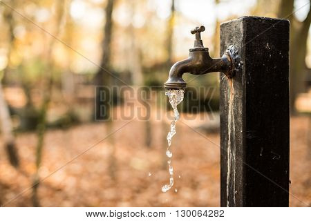 Wasting the Water Concept Photo. Leaking Water Source.