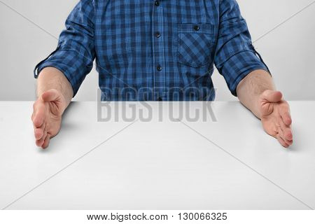 Close-up hands of man in the forming a frame to show big size. Concept. Symbols and gestures. Body language. Hand gesture. Cropped portrait.