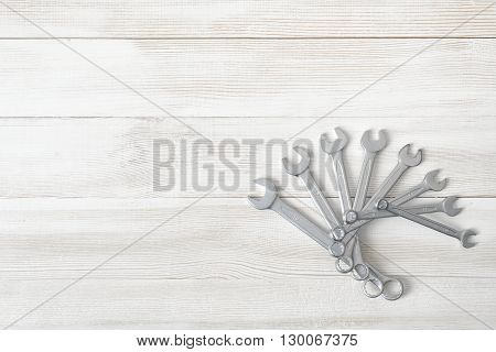 Different sized wrenches laid out in the helix form in top view. Hexagonal shape. Hand tool. Tools for carpentry work. Type of fastener. Mend and repair. Parts for repair. poster