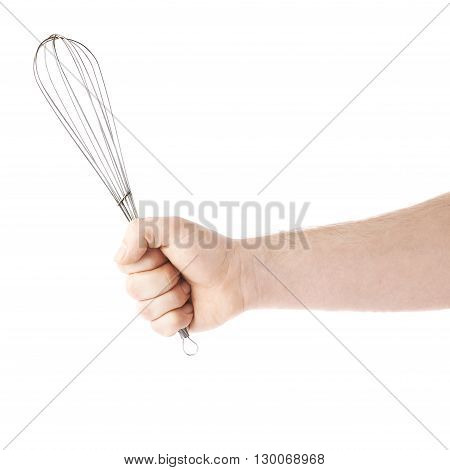 Caucasian male hand holding a egg beater mixer whisk, composition isolated over the white background