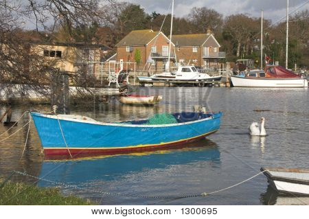 River Mooring With Boat & Swan