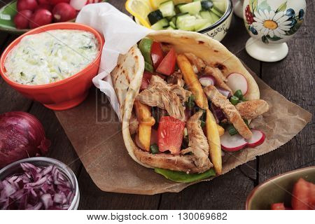 Doner kebab, turkish pita bread sandwich wit meat slices and vegetables