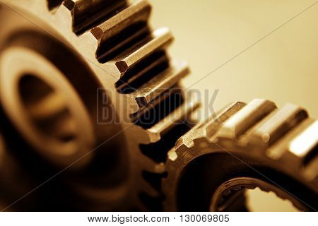 Closeup of two metal cog gears