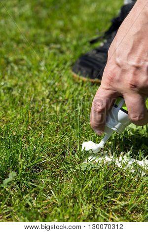 Closeup Referee With Vanishing Spray On Turf