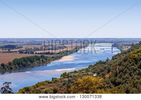 The Tagus River (Rio Tejo), the largest of the Iberian Peninsula, and the Leziria landscape seen from Portas do Sol belvedere. Santarem, Portugal.