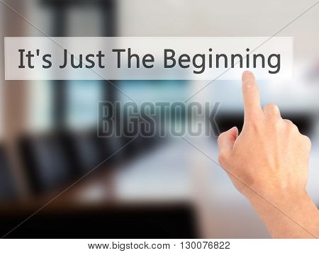 It's Just The Beginning - Hand Pressing A Button On Blurred Background Concept On Visual Screen.