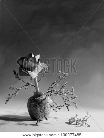 Black and white still life of rose flowers. Beautiful vase of roses. Nice paper rose. Cute, upset still life with lights and shadows. Beautiful still life flowers with dark tones. Paper flowers. Black rose.