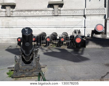 historic cannons on display entry The Royal Museum of the Armed Forces and Military History in Cinquantenaire Park in Brussels Belgium Europe
