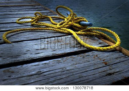 Old Wooden Dock with Yellow Rope water shoreline
