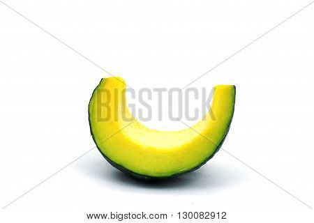 A piece of pumpkin on white background. A sliced seedless pumpkin on white background.