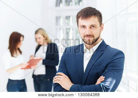 The smiling male and female office workers