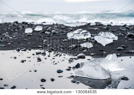 Icebergs on black volcanic sand beach near Jokulsarlon glacier lagoon Southern Iceland