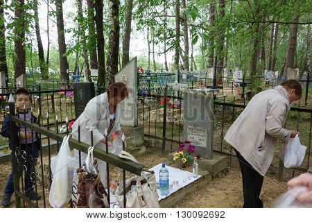 Borisov Belarus - 10 May 2016: Radunica - spring holiday of remembrance of the dead in the eastern Slavs. People come to the cemetery to remember deceased relatives.