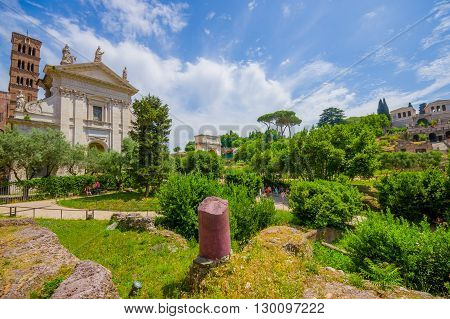 ROME, ITALY - JUNE 13, 2015: Inside Roman Forum, nice little ancient city and  big temple in the middle.
