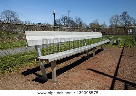 The metal dugout bench on the baseball field