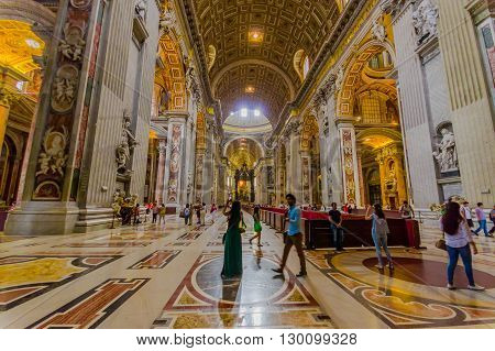 VATICAN, ITALY - JUNE 13, 2015: Main hall entrance and view of Saint Peter Basilica at Vaticano, gold covered, spectacular place.