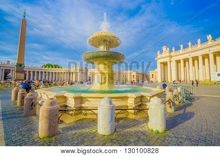 VATICAN, ITALY - JUNE 13, 2015: Clasic and old fountaine outside Saint Peter square at Vatican, nice water color with obelisk at the back.