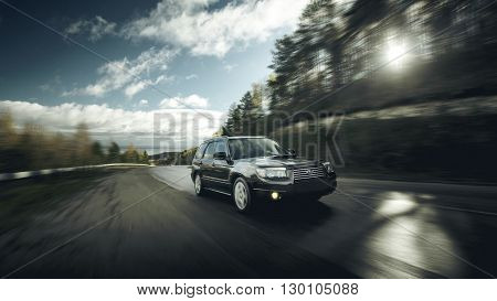 Khvalynsk, Russia - November 04, 2015: Black car Subaru Forester fast drive on asphalt road at daytime