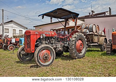 VILLA ROTTA FORLI ITALY - MAY 1: vintage tractor Ferguson TEF 20 with military trailer in rally of classic tractor during the feast