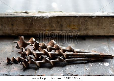 Old hand drill bits in a workshop augers