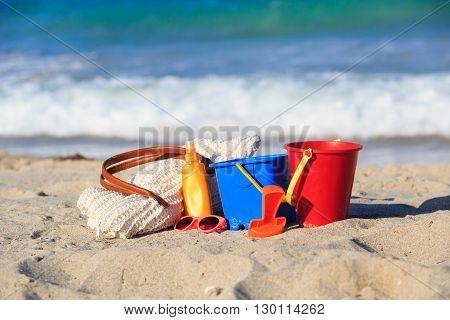 beach bag, suncream, kids toys on the beach, vacation concept