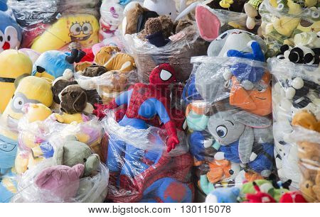 Hanoi, Vietnam - May 14, 2016: Colorful made in China Spiderman puppets and teddyand doll for sale at Hang Ma old street in Hanoi quarter streets area.