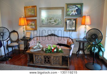 KEY WEST, FL, USA - DEC 20: Living Room of Ernest Hemingway House and Museum on Dec 20, 2012 in Key West, Florida, USA. Ernest Hemingway House is Ernest Hemingway's home from 1931 to 1939.