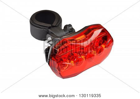 Red light bike reflector isolated on white background