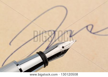 signature and a fountain pen