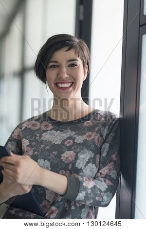 portrait of  young businesswoman in casual hipster clothes at modern startup business office interior