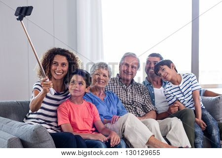 Happy family taking a selfie in living room at home