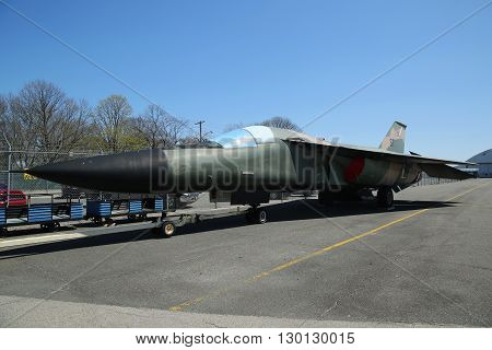 FARMINGDALE, NEW YORK - APRIL 14, 2016: General Dynamics F-111 Ardvark on display at the American Airpower Museum in Farmingdale,  New York.